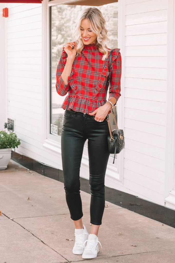 black coated jeans and red plaid ruffle top