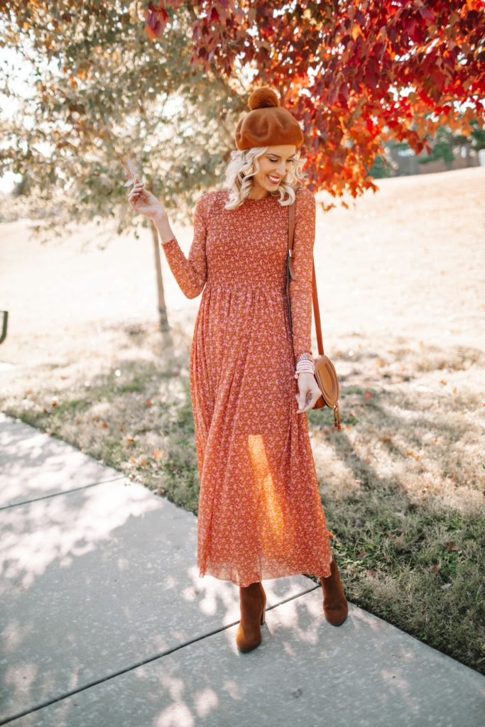 orange and red colored fall midi dress and boots with beret