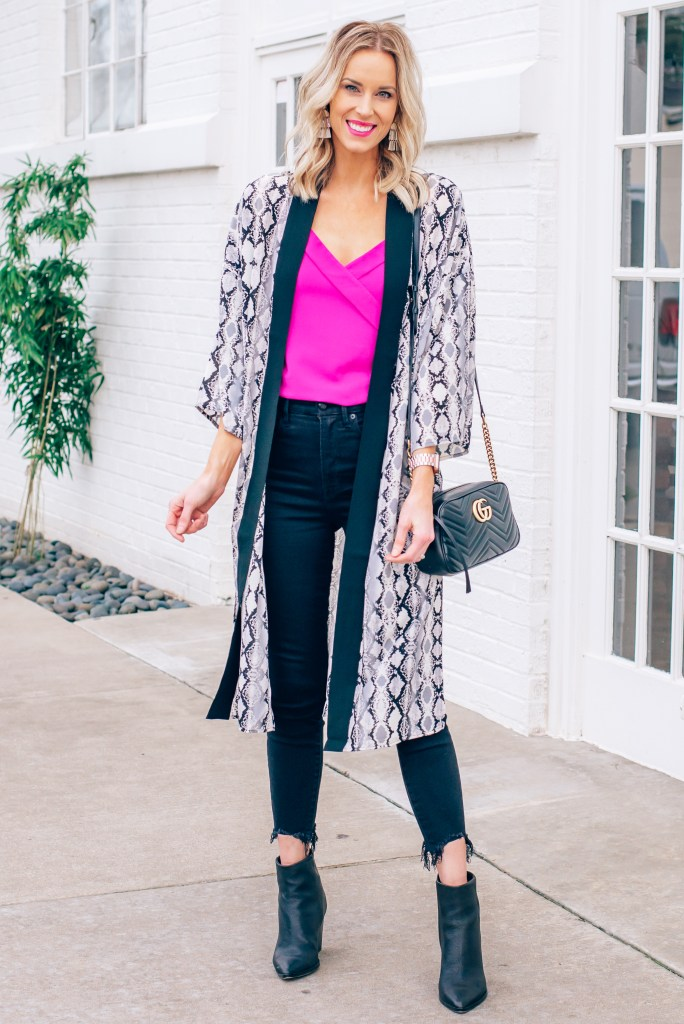 hot pink cami with black jeans and snakeskin duster