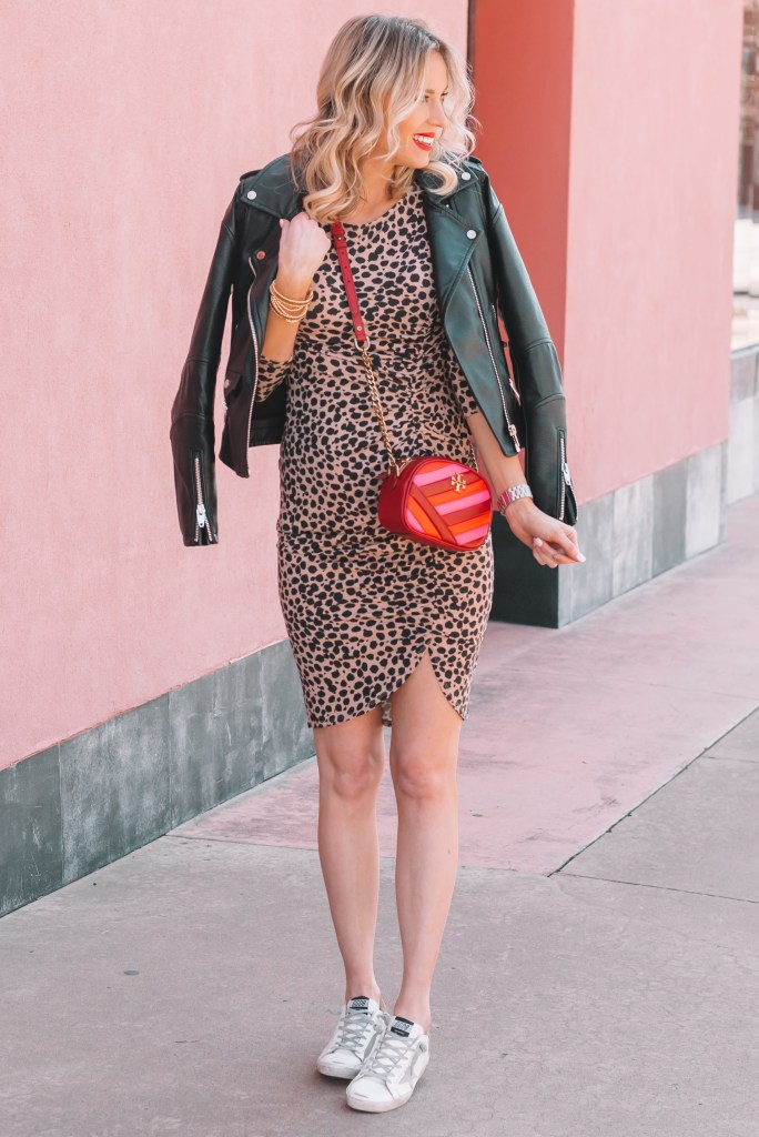How to Style a Leopard Dress Casually, ruched leopard dress, sneakers, leather jacket, red bag