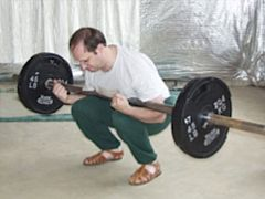 Tom Black performing a Zercher Squat