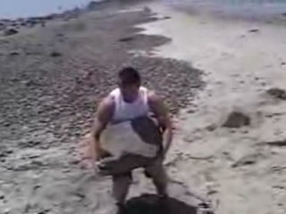 Stone lifting at the beach