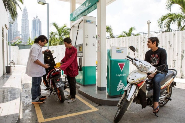 Image result for motorcycle malaysia gas station