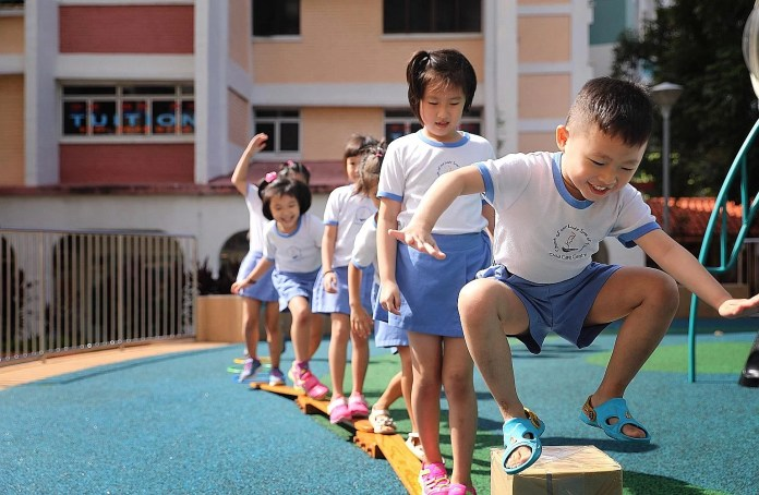 Children from Our Lady Star of the Sea Child Care Centre in Yishun at the outdoor playground last Tuesday. The school's enrolment has held steady at around 85 children in the past few years, but it used to have about 100 children a decade ago.