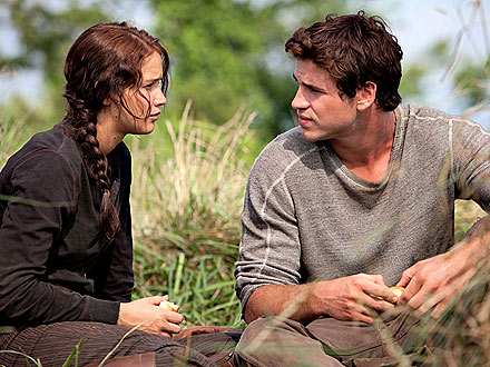 Jennifer Lawrence as Katniss & Liam Hemsworth as Gale