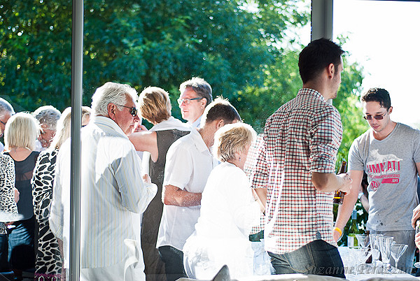 Guests clustered around the bar on the balcony