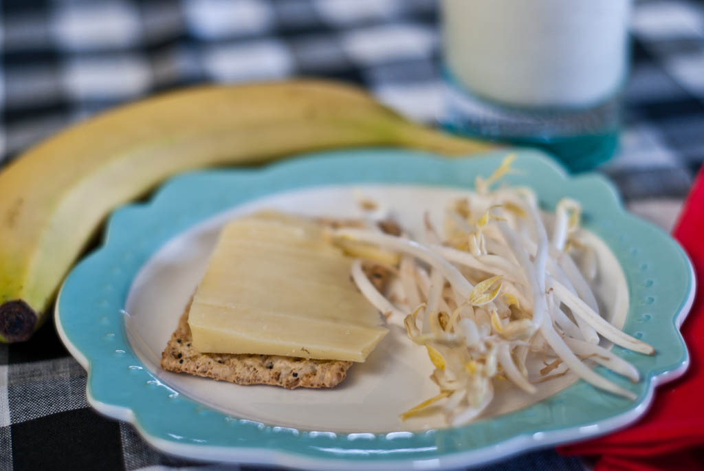 Afternoon Snack: Cracker, hard cheese, sprouts, banana and milk