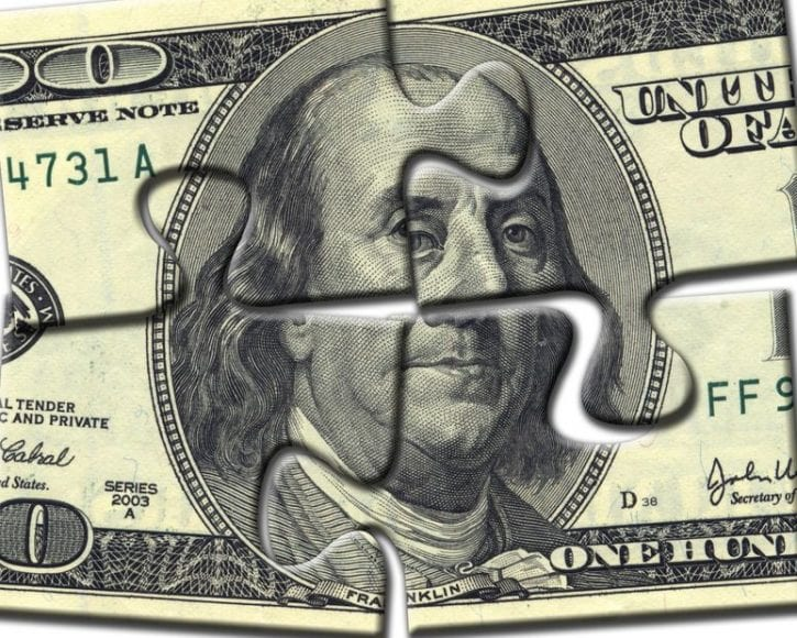 4701722 - image of dollar made of puzzles over white background