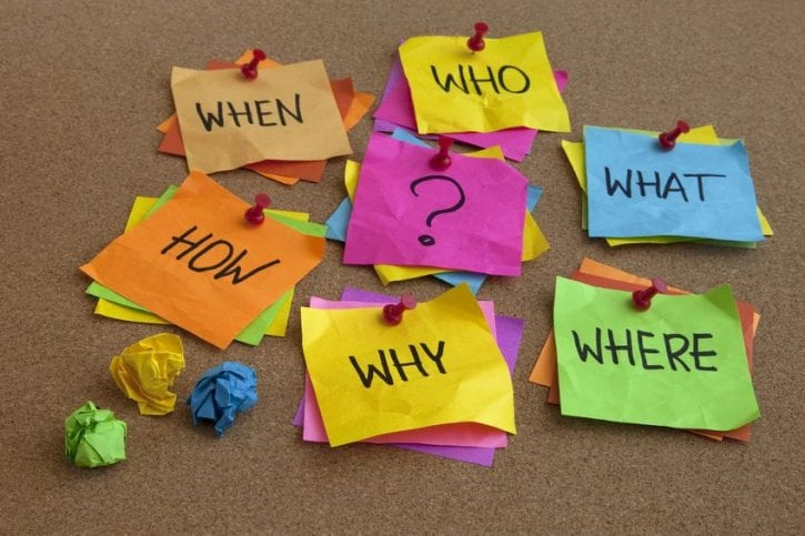 5699091 - who, what, where, when, why, how questions - uncertrainty, brainstorming or decision making concept, colorful crumpled sticky notes on cork bulletin board