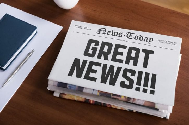 16790322 - newspaper with hot topic  great news  lying on office desk