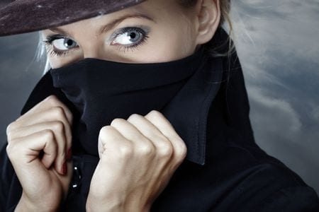 5679393 - female spy in hat with face covered by the coat collar