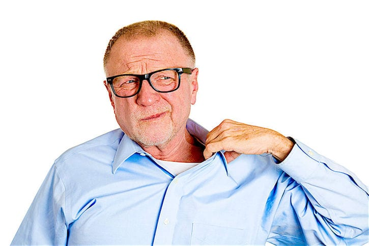 27182068 - closeup portrait senior mature man in black glasses opening shirt to vent, it's hot, unpleasant, awkward situation, embarrassment. isolated white background. negative human emotions, facial expression