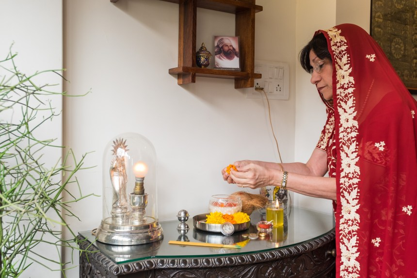 A Parsi woman performs a ceremony at home associated with Lakshmi, the Hindu goddess of wealth.