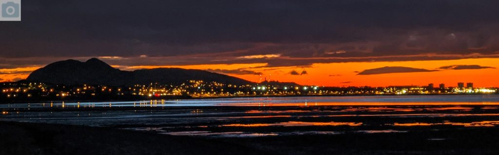 Edinburgh skyline at dusk, looking over from Musselburgh