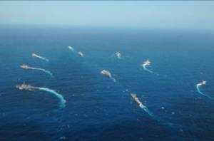 Warships of the three navies in formation.