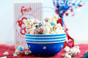 "Firecracker popcorn mix is the perfect sweet, salty, festive snack to add a little ""pop"" to your Fourth of July party this year. This mix features Pop Rocks to give your tastes buds an explosion of flavor. Kids and adults alike will love the popping of ""firecrackers"" in their mouths."