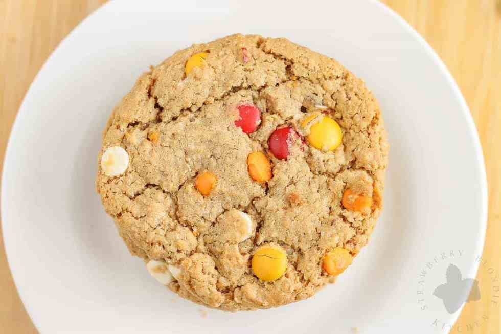 Monster cookies taken up a notch with the flavors of Autumn are both delicious and festive. Peanut butter mixed with pumpkin pie spice, white chocolate and pumpkin spice flavored chips and fall colored m & m's make these autumn monster cookies the perfect treat to serve all season long!