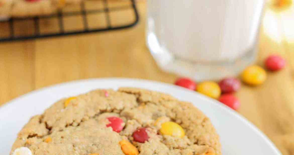 Monster cookies taken up a notch with the flavors of Autumn are both delicious and festive. Peanut butter mixed with pumpkin pie spice, white chocolate and pumpkin spice flavored chips and fall colored m & m's make these autumn monster cookies the perfect treat to serve all season long! | Strawberry Blondie Kitchen