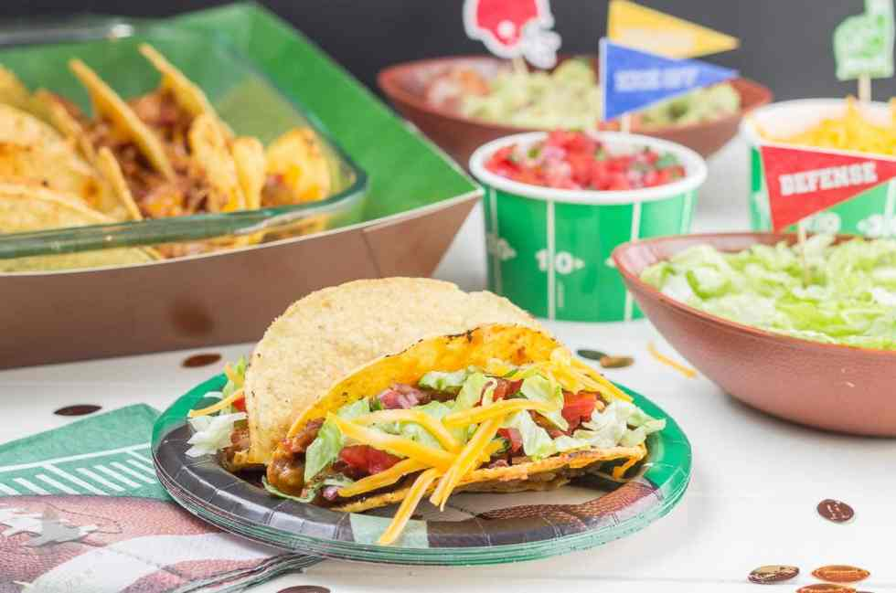 Easy and delicious Healthier Oven Baked Tacos are super simple to make, feed a crowd and use ingredients that you can already find in your pantry. Perfect for watching the BIG GAME and feeding the hungry football fans! | Strawberry Blondie Kitchen