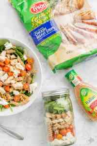 Quick and easy, healthy, portable and delicious, this Layered Chicken Caprese Salad is a meal in a jar. It can be made the night before to save time in the morning or is a perfect prep ahead dinner meal. | Strawberry Blondie Kitchen