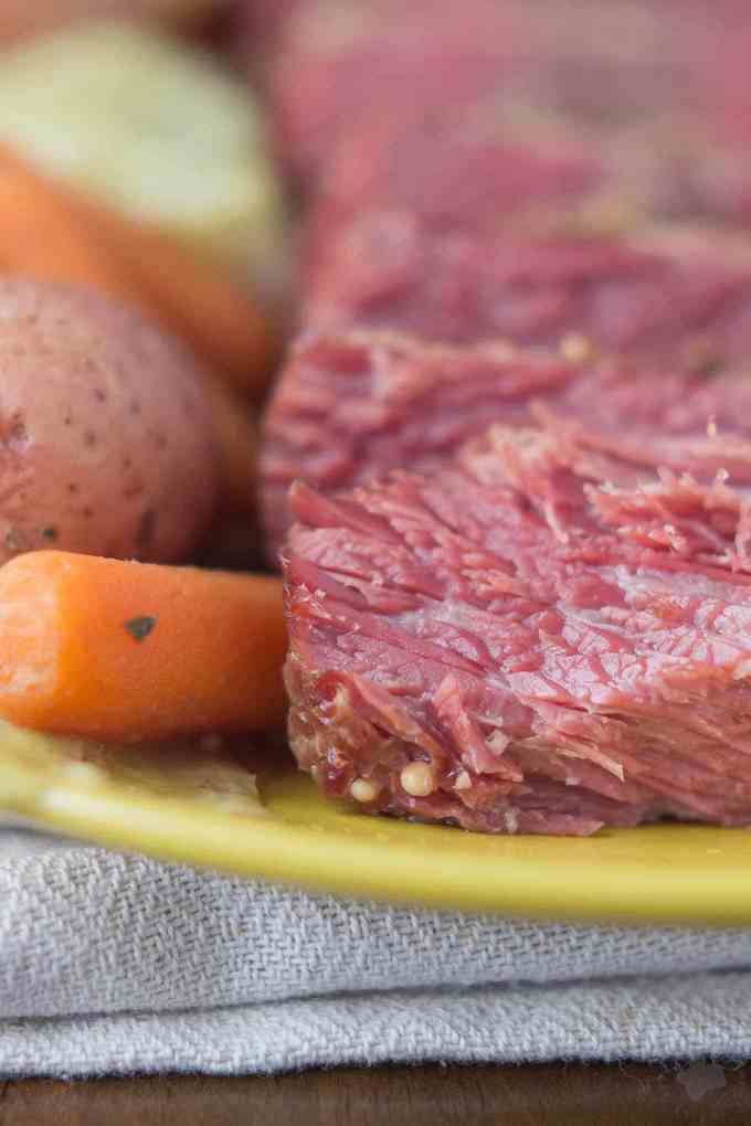 Running short on time but would like to make a traditional Irish dish for dinner this St. Patrick's Day? Slow Cooker Corned Beef with Cabbage and Potatoes is easy, hands off and delivers a moist and tender piece of meat. Throw in cabbage, potatoes and carrots, and you've got yourself the perfect meal and a little piece of Irish luck on your side! | Strawberry Blondie Kitchen
