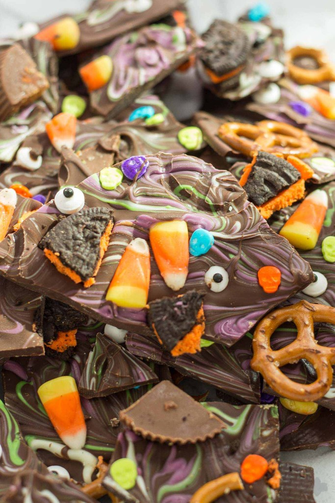 Halloween Candy Bark is a fun and spooky way to bring the deliciousness of Halloween candy into a colorful, no bake bark your whole family can customize. Use Hefty® Slider Bags and cleanup is a breeze! | Strawberry Blondie Kitchen