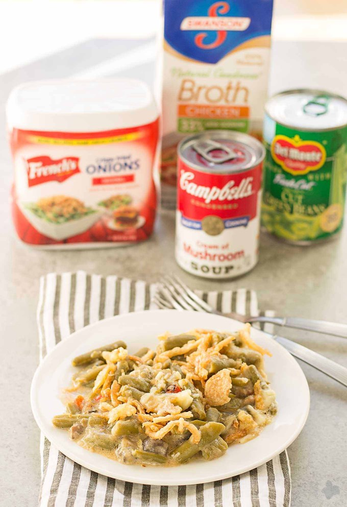 Sharp white cheddar cheese elevates this Slow Cooker White Cheddar Green Bean Casserole to make it the star side dish of your holiday table! | Strawberry Blondie Kitchen