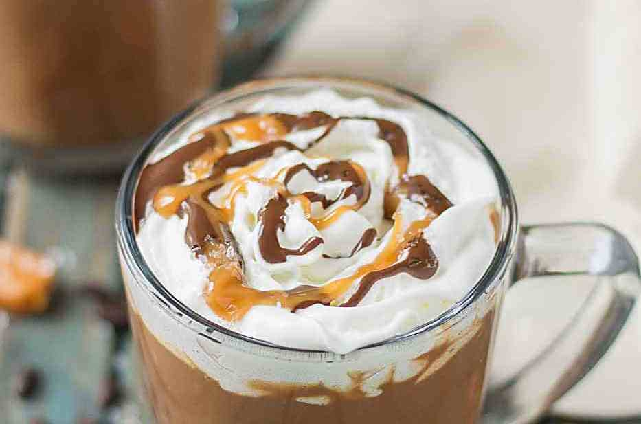 Creamy espresso blends perfectly with chocolate and almond milk, topped with whipped cream, caramel drizzle and a sprinkle of sea salt, making this Sea Salt Caramel Mocha irresistibly delicious! | Strawberry Blondie Kitchen