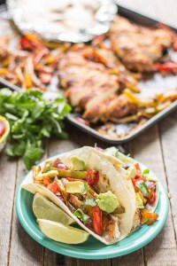 Bursting with flavor and cooked all on ONE pan, these easy Sheet Pan Chicken Fajitas are sure to become permanent in your dinner rotation. You'll love the quick cleanup too! | Strawberry Blondie Kitchen