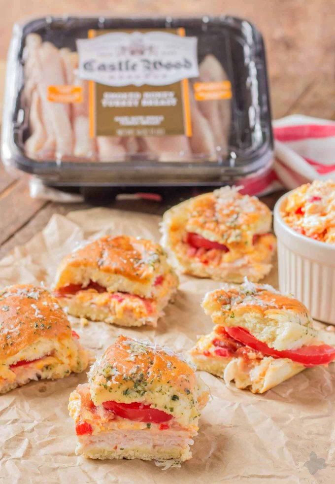 A twist on the classic hot brown, these Kentucky Hot Brown Sliders feature Castle Wood Reserve® honey turkey breast, homemade pimento cheese, bacon and tomatoes. The perfect appetizer to add to your Kentucky Derby Party. | Strawberry Blondie Kitchen
