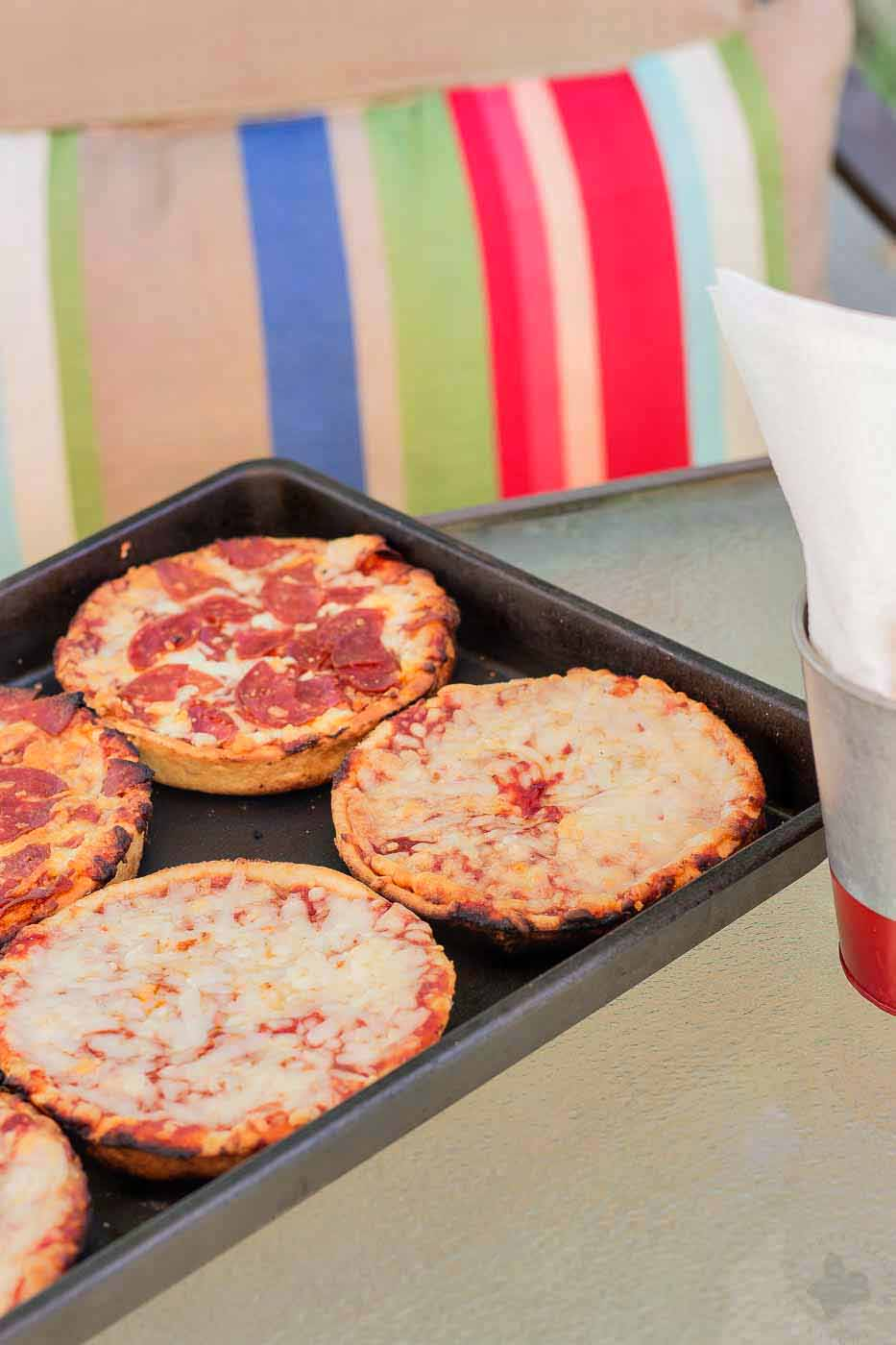 Summertime pizza parties have never been easier and simpler thanks to Easy grilled pizzas with Red Baron Singles Deep Dish pizzas. Throw a few on the grill and you've got yourself a pizza party faster than you can call the delivery man. | Strawberry Blondie Kitchen