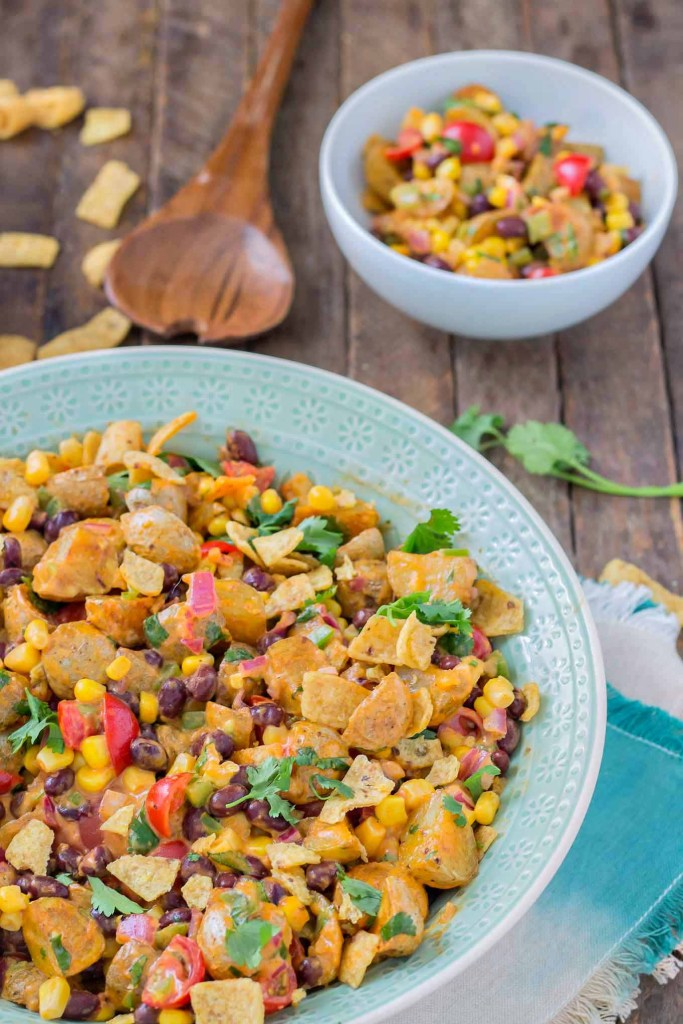 This Mexican Potato Salad is bursting with delicious flavor. Corn, black beans, cherry tomatoes, cilantro and Frank's Redhot Buffalo Wing Sauce make for one amazing side dish for all your summertime gatherings. | Strawberry Blondie Kitchen