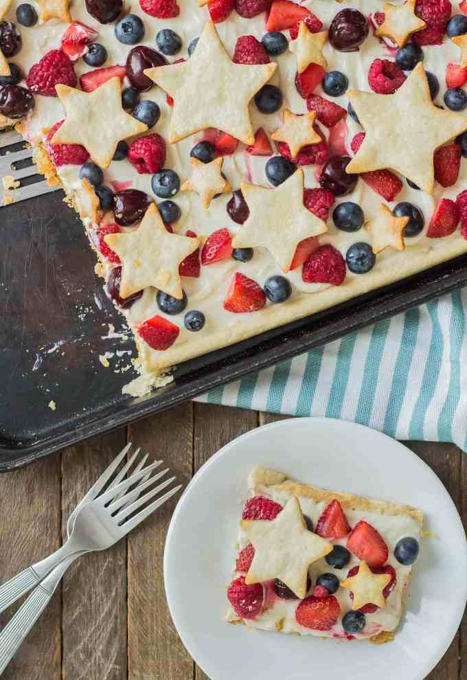What is more Patriotic than a Star Spangled Berry Sheet Pan Pie?  It's an all American pie loaded with berries, citrus flavors and studded with pie stars.  A delicious addition to all your festive parties this year! | Strawberry Blondie Kitchen