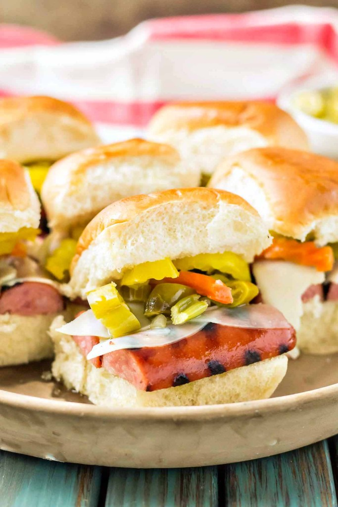 Chicago Style Italian Smoked Sausage Sliders feature Eckrich Smoked Sausage, provolone and giardiniera on a slider roll. A twist on the classic sandwich, you'll love this bite sized version even more! | Strawberry Blondie Kitchen