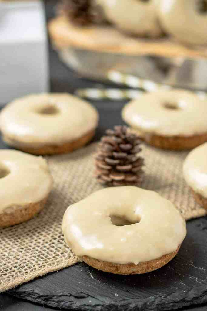 TheseApple Cider Donuts with Maple Frosting are perfect on a crisp fall morning with a hot cup of coffee. They're moist, delicious and bursting with apple and maple flavors. | Strawberry Blondie Kitchen