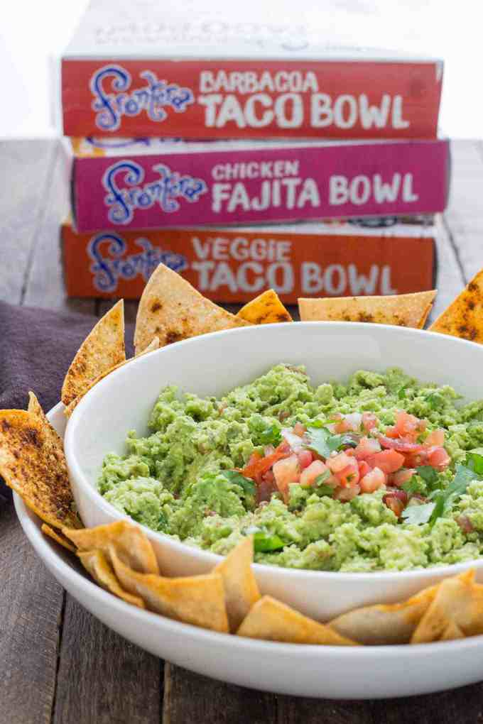 All the flavors you love of guacamole with an added boost of protein and fiber make this Edamame Guacamole super flavorful and a good for you dip. Paired with homemade smoky tortilla chips and you've got one delicious snack. | Strawberry Blondie Kitchen