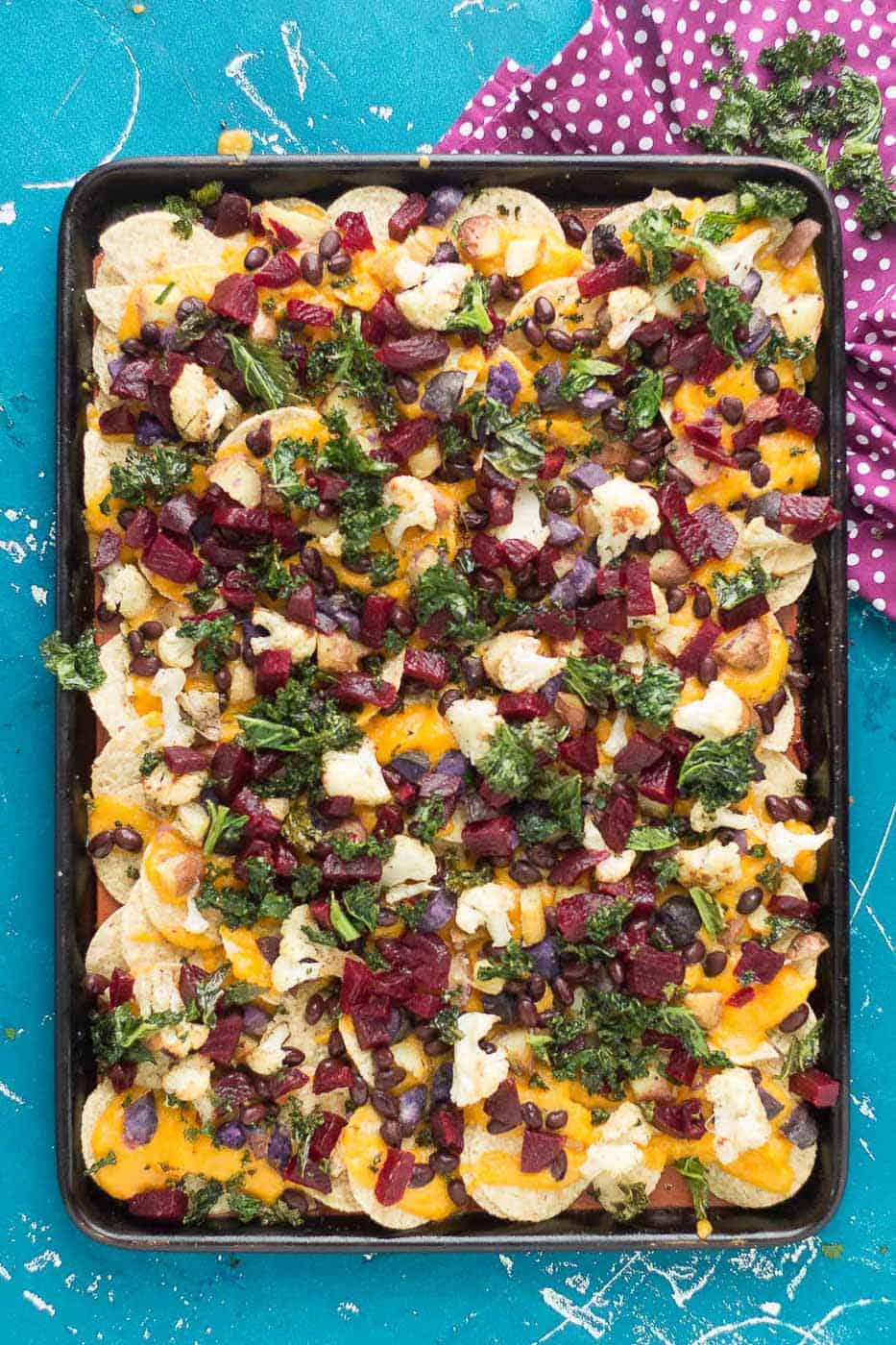 Fall Bounty Sheet Pan Nachos have butternut squash nacho cheese sauce, black beans, kale, roasted cauliflower and beets to give you the ultimate in snacking with all of Fall's delicious produce! | Strawberry Blondie Kitchen