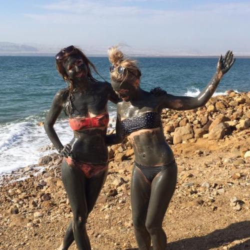 Covering ourselves in mud before going for a bob in the Dead Sea in Jordan