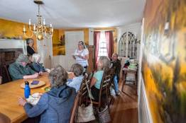 Lisa Drnec Kerr, the featured writer at the Straw Dog Writers Guild's writers read, and an associate professor of English at Western New England University, reads a selection of her work at the Inn at Norton Hill in Ashfield, Sunday, August 6, 2017.