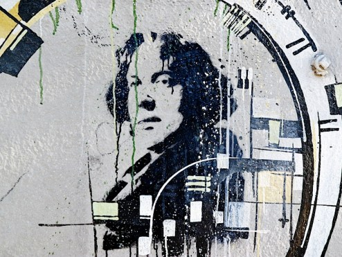a painting of oscar wilde outside of pegasus books in berkeley, CA