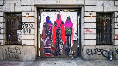 mysterious cloaked wheatpaste figures found on lafayette street in NYC