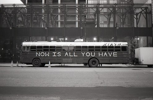 a bus which reads now is all you have on the streets of nyc
