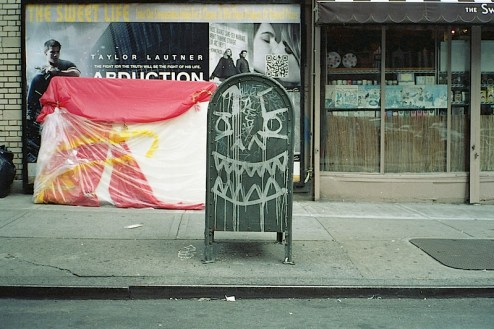 a graffiti covered mailbox in the lower east side of nyc