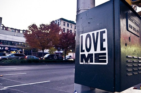 a street art sticker by love me aka curtis kulig on the streets of NYC