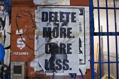 delete more care less street art found in SoHO, NYC