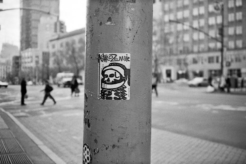 a graffiti street art sticker by astrozombie found in SoHo, NYC