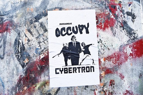 occupy cybertron street art by suckadelic