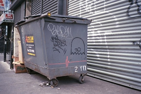 a pacman ghost and graffiti by infinity found on a dumpster on ludlow st in the lower east side of NYC