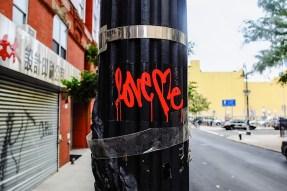 love_me_graffiti_sticker_lower_east_side.jpg