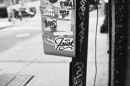 a graffiti sticker by faust found in SoHo, NYC